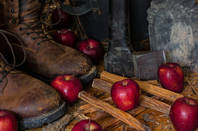 workboots in apple barn, with axe and apples  - still life, by Michael J Zittel/shutterstock