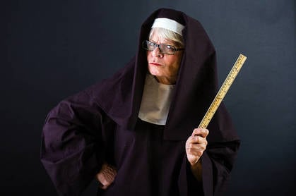 A mean looking nun with a ruler