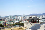 Hwaseong fortress wall - 18th century ramparts built by King Jeongjo in the foreground of Korea's Suwon City - where Samsung has a manufacturing plant