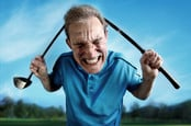 An angry, frustrated golfer bends a club over his head