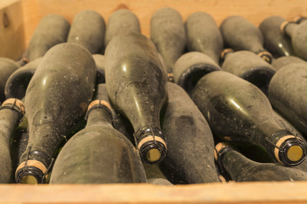 Old wine bottles gathering dust