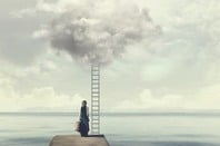 A woman standing by a ladder to a cloud