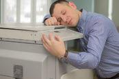man hugs printer