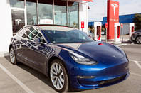 California January 6, 2018: navy tesla model 3 charging at supercharger station Aleksei Potov / Shutterstock.com
