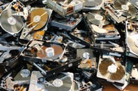 broken hard drives in a pile - pic by shutterstock