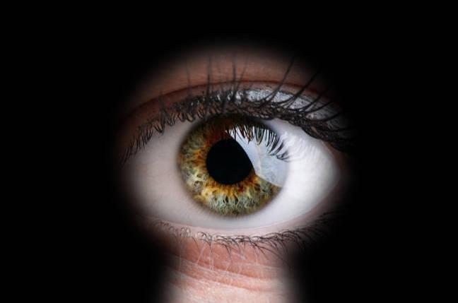 Stalker: woman peers through keyhole