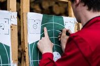man checks target at a rifle range