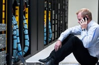 man on mobile phone in a data centre