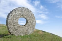 Stone wheel on hillside