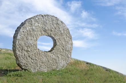 Stone wheel on hillside