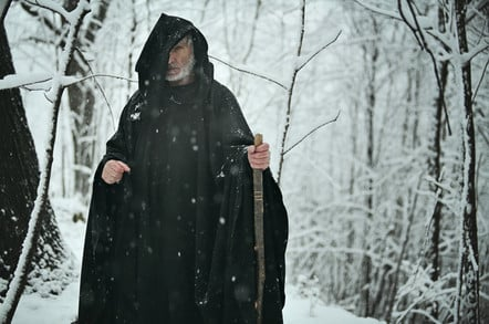 Old wizard in snowy forest