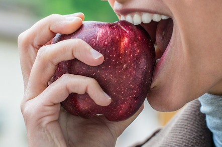 Person eating an apple