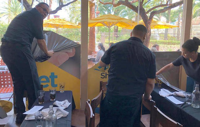 Restaurant staff tearing down IGEL's branding near VMworld 2018
