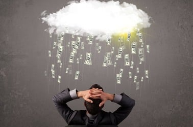 Money raining from cloud on man