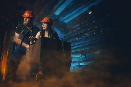 "Two miners (cosplay) carrying coal up ""mine shaft"" -"