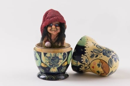 A troll emerging from a nesting doll