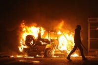 Dissident walking away from burning vehicle