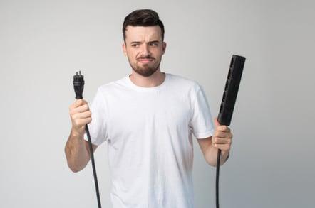 Man holding plug socket
