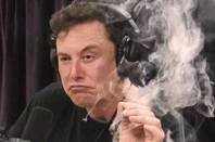 Elon Musk smoking a spliff on Joe Rogan's podcast