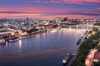 Aerial panorama of Bratislava, new bridge over Danube river with evening lights in capital city of Slovakia,Bratislava