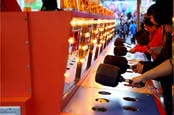People playing whack-a-mole game