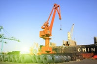 strip steel and crane in bulk terminal, closeup of Tianjin. shutterstock