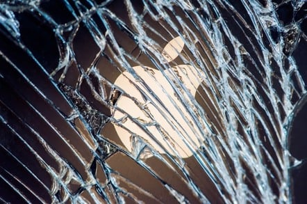 Apple logo behind broken window