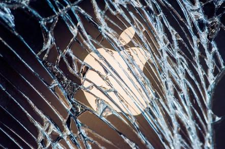 Apple logo behind broken window