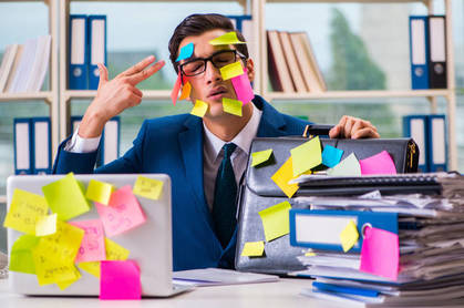 man with post-its all over face