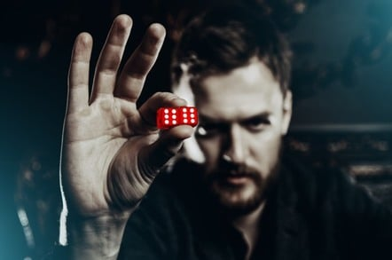 man holding dice