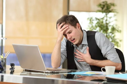 Man has panic attack in front of computer
