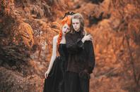 Gloomy couple on autumn background