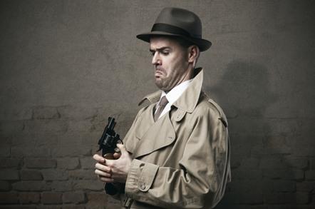 Spy pointing gun at himself