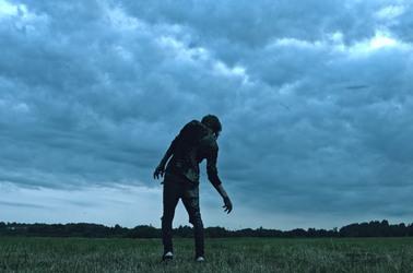 A zombie shambling across a field