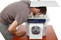 man copies face in photocopier