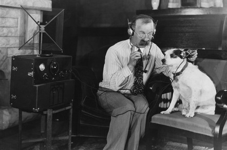 Man and dog listening to headphones