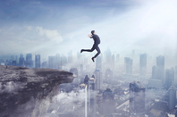 business person  jumps into air