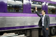 Suit waves goodbye to train
