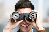 Man with binoculars sees money