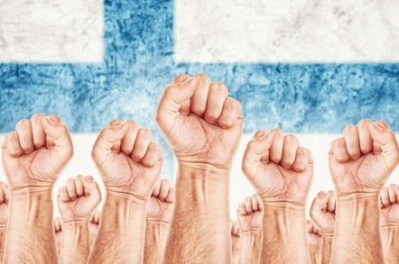 Fists raised in front of Finland's flag