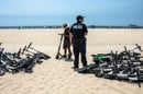 Scooters strewn about beach