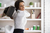 woman hurls laptop across office