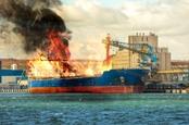 Cargo ship in port, burning
