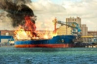 Cargo ship in port, burning