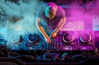 deejay at mixing deck - party fun EDM