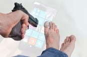 Man shooting himself in the foot overlaid with Windows Phone image