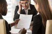 A man looks nervous at an interview