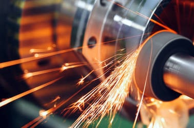 Sparks flying while machine grinding and finishing metal
