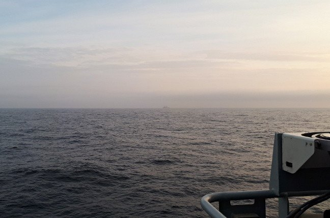 The Arctic Sea, with the USS New York as a distant blot on the horizon. Pic: Gareth Corfield