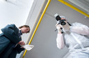 investigators with camera rubber gloves collect evidence